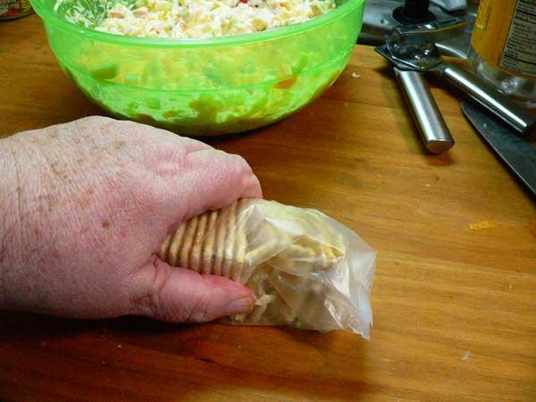 Veg-All Casserole, crumble the crackers.