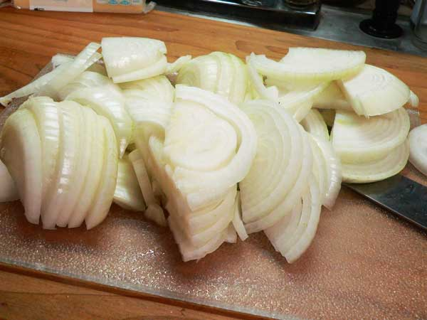 Onion Casserole, slice the onions.
