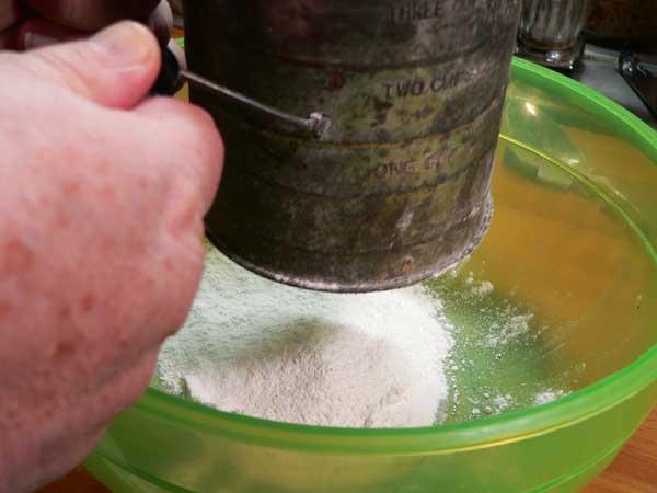 Black Walnut Cake, sift flour.