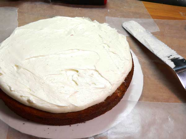 Black Walnut Cake, spread the frosting.