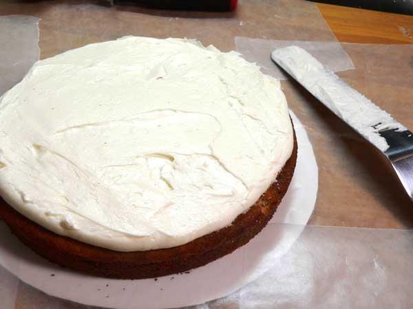 Black Walnut Cake, spread the frosting.