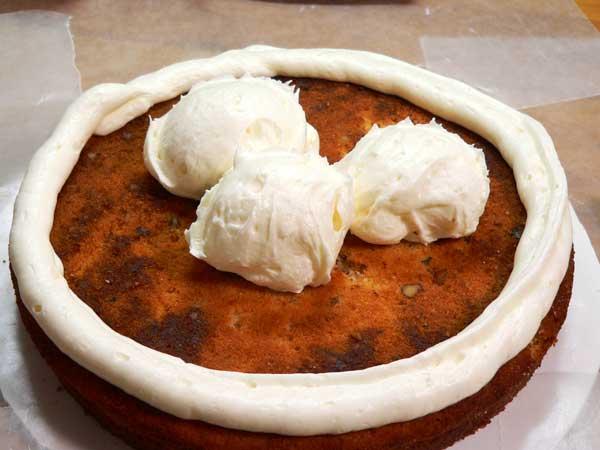 Black Walnut Cake, scoop out frosting.