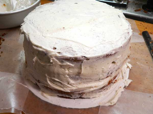Black Walnut Cake, apply the crumb coat.