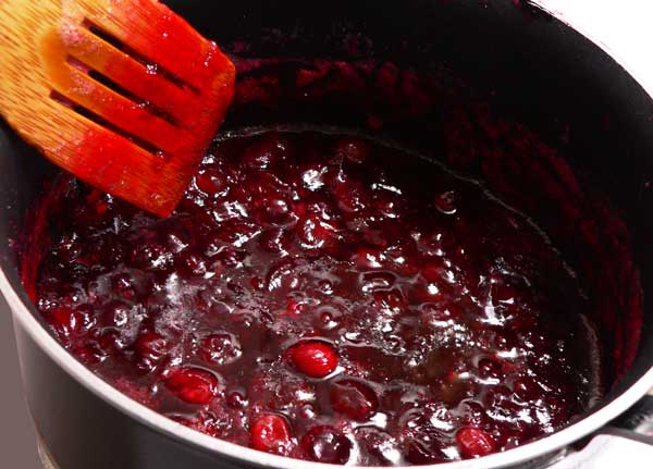 Cranberry Sauce, simmer and let thicken.