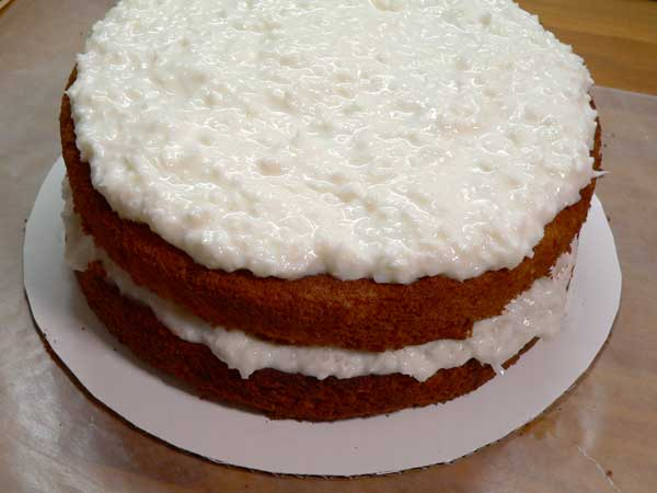 Sour Cream Coconut Cake, repeat the process with the second cake layer.