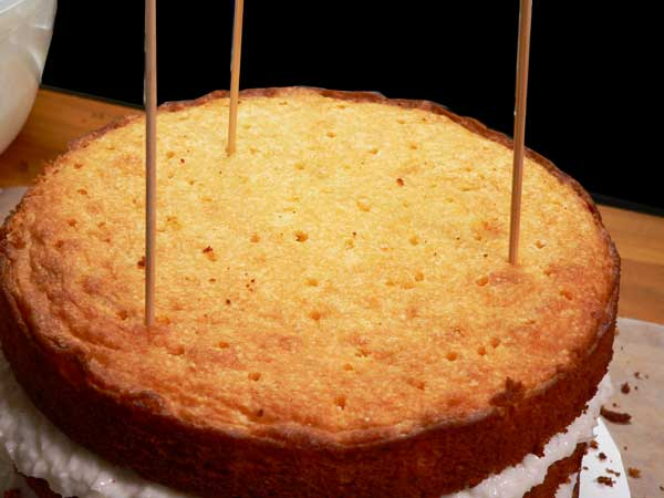 Sour Cream Coconut Cake, add wooden dowels.