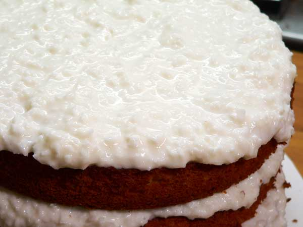 Sour Cream Coconut Cake, frost the top layer.