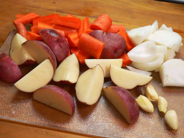 Clay Pot Chicken, prepare your vegetables while the pot is soaking.