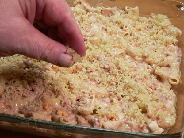 Corned Beef Casserole, spread the buttered breadcrumbs over the top of the casserole dish.