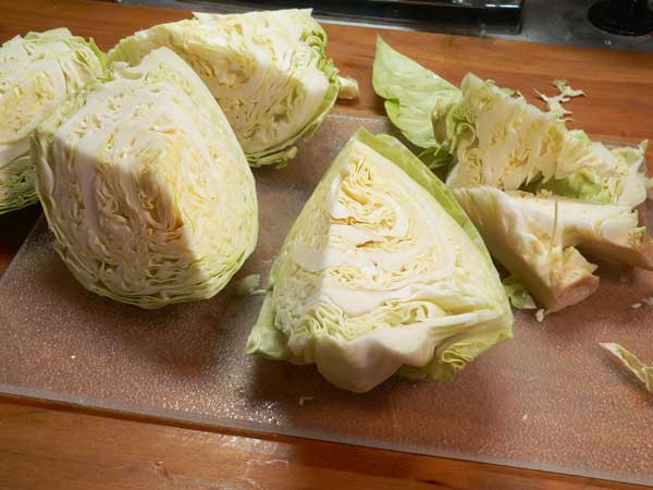Corned Beef and Cabbage, quarter the cabbage and remove the core.