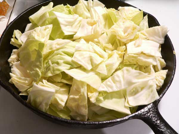 Corned Beef and Cabbage, add the cabbage to the skillet.
