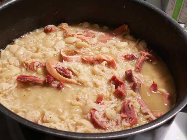 Lima Beans with Ham Hocks and Rice, cook until the rice and beans are done.