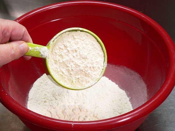 Sourdough Bread, add the flour.
