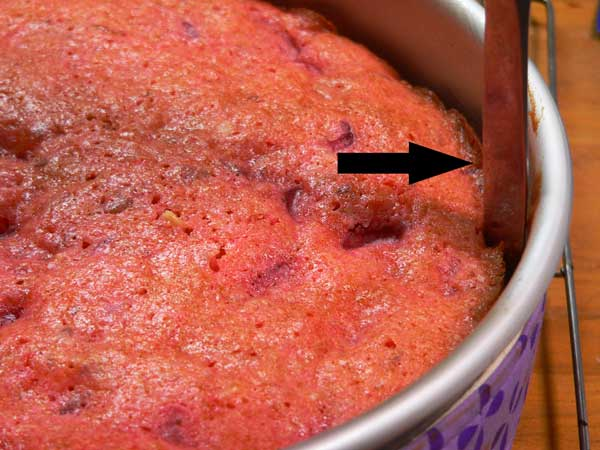 Strawberry Nut Cake, run a butter knife around the inside of the pan.