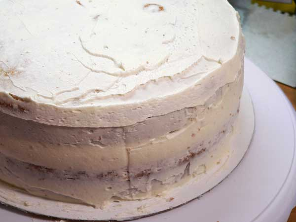 Easter Bunny & Eggs Cake, crumb coat the outside layers.