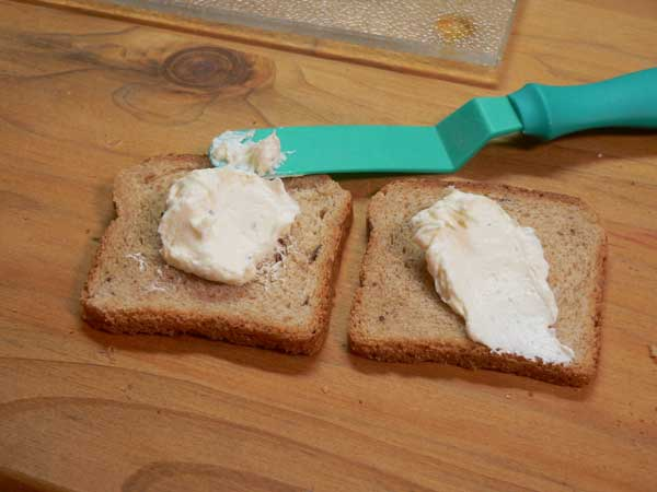 Cucumber Sandwiches,spread the cream cheese on the bread.