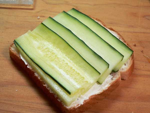 Cucumber Sandwiches, place the slices of cucumber on the bread.