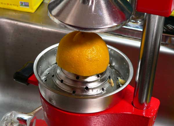Lemonade, place the lemon on the juicer.