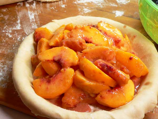 Peach Pie, place peaches in crust.