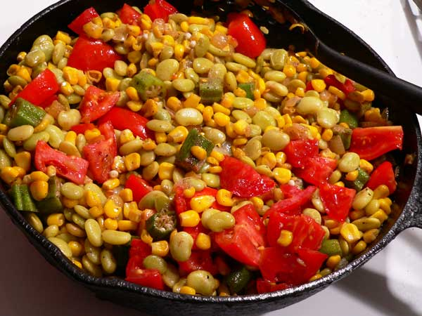 Succotash, stir and cook until tomatoes are hot.