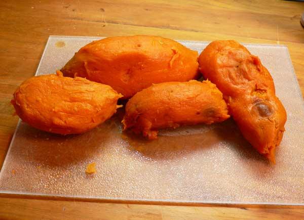 Candied Yams, peel the potatoes.