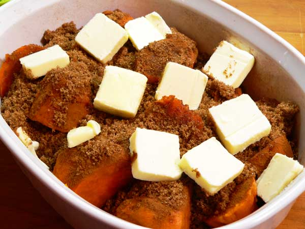 Candied Yams, add the slices of butter.