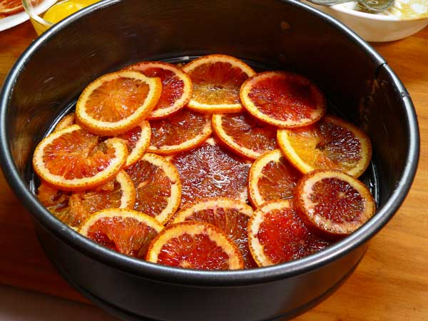 Cornmeal-Ricotta, layer the orange slices.