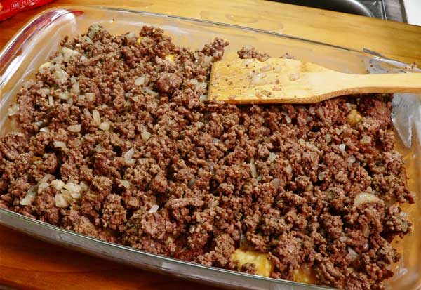 Tater Tot Casserole, spread beef in dish.