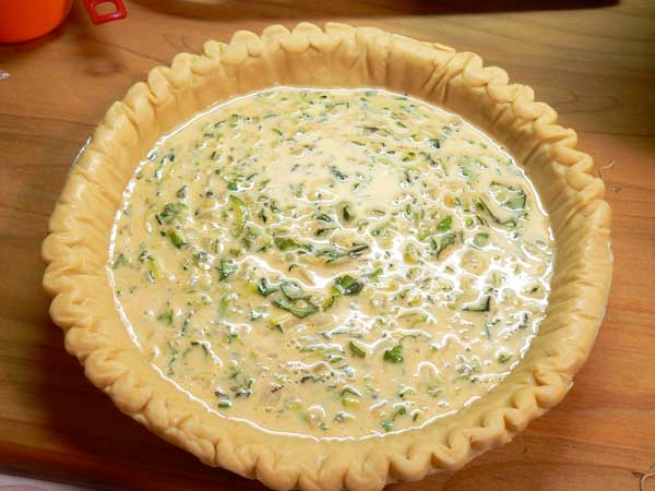 Zucchini Quiche, add the filling.