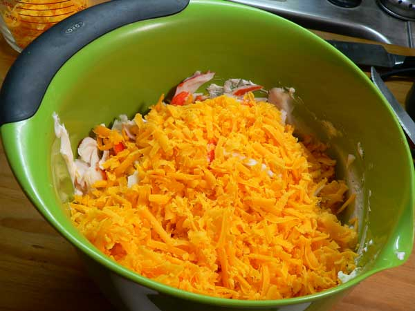 Crab Dip, add the grated cheese.