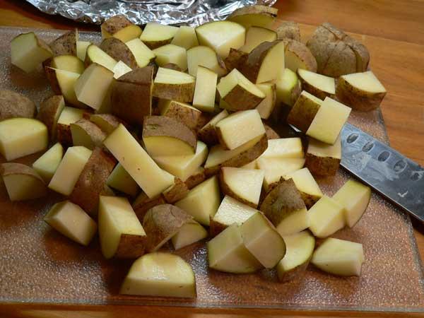 Potato Ham Bone Soup, cube the potatoes.