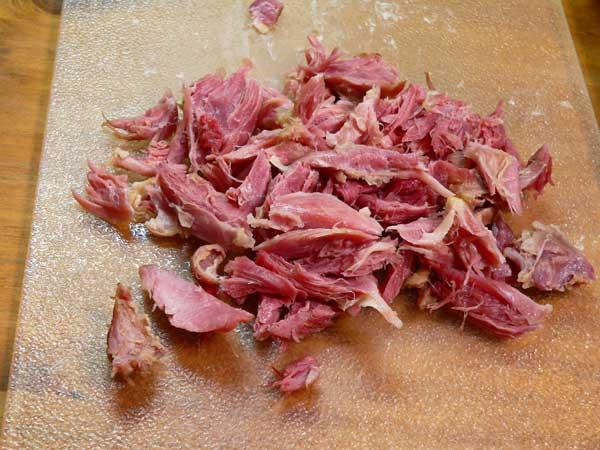 Potato Ham Bone Soup, remove meat from ham bone.