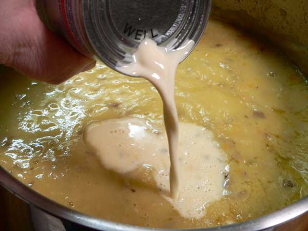 Potato Ham Bone Soup, add the evaporated milk.