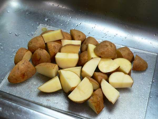 Corned Beef Brisket, cut the potatoes.