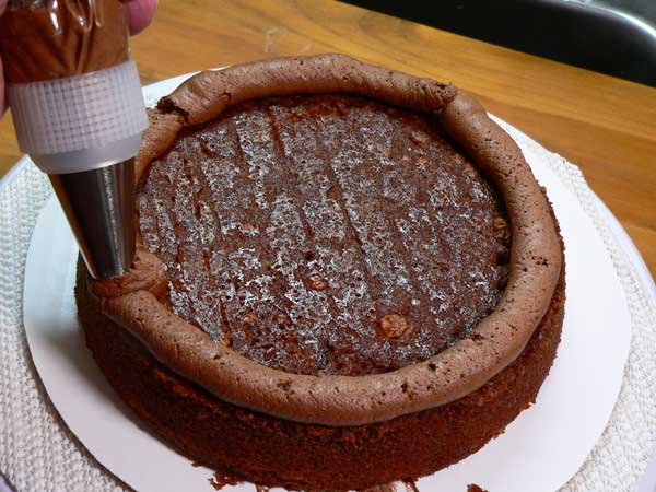 German Chocolate Cake, add first layer.
