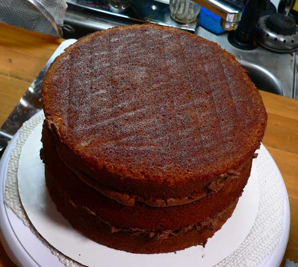 German Chocolate Cake, add the top layer.