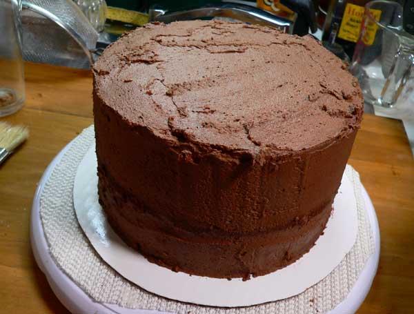German Chocolate Cake, add the crumb coat.