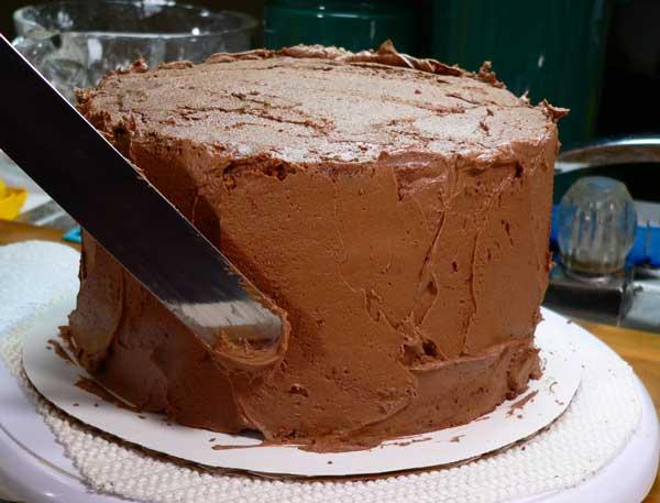 German Chocolate Cake, apply frosting.