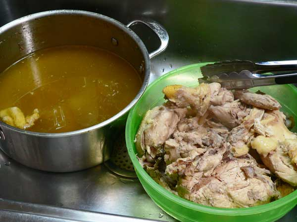 Chick A Hog BBQ, remove chicken from broth.