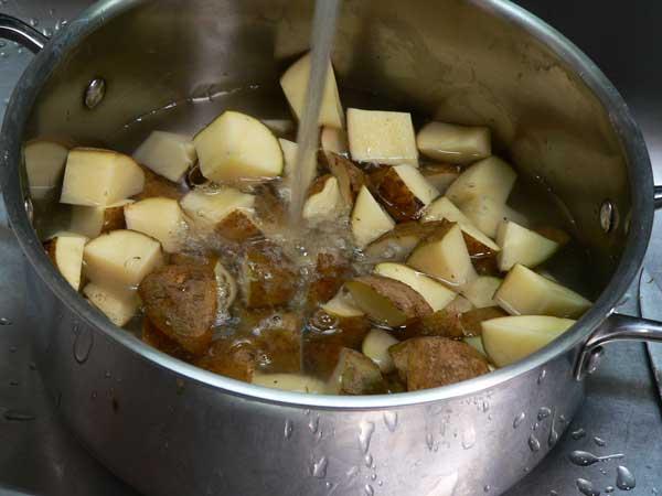 Loaded Potato Casserole, cut the potatoes.