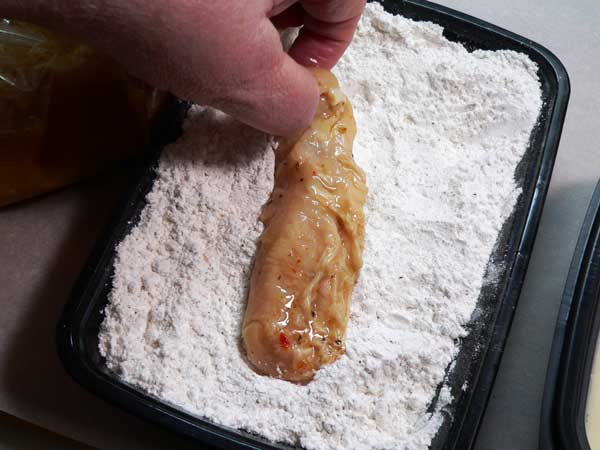 Chicken Strips, coat with flour.