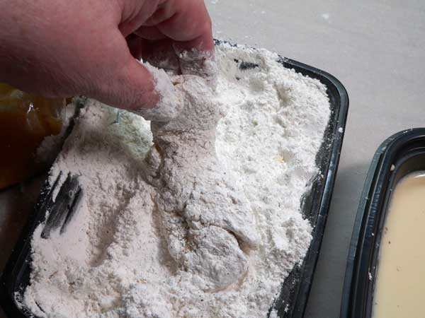 Chicken Strips, dip back into the flour.