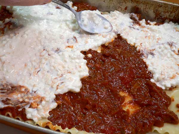 Lasagna, add sauce and cottage cheese.