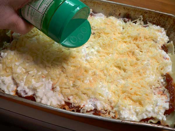 Lasagna, add the Parmesan cheese on top next.