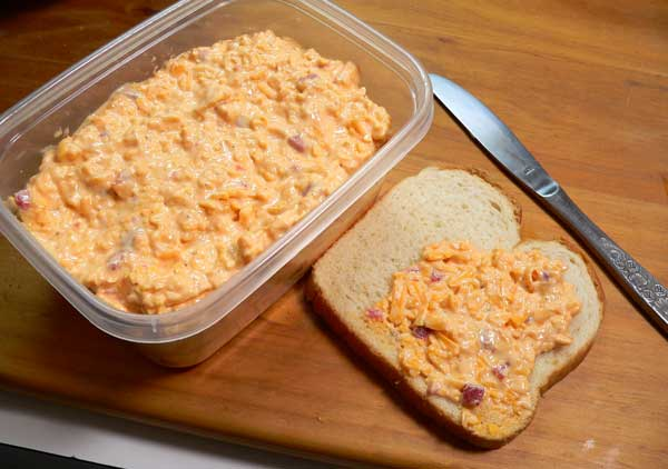 Pimento Cheese, place in container.