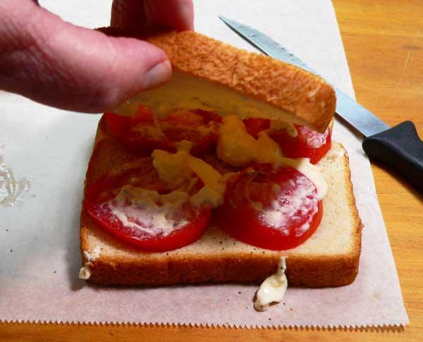Tomato Sandwich, add the top slice of bread.