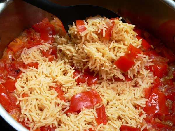Tomatoes and Rice, fluff with a fork.