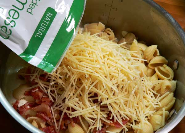 Bacon Ranch Pasta Salad, add the cheese.