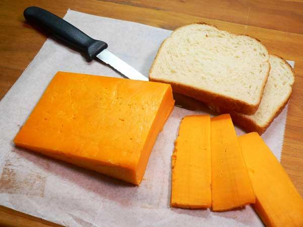 Hoop Cheese Toast, slice the cheese.