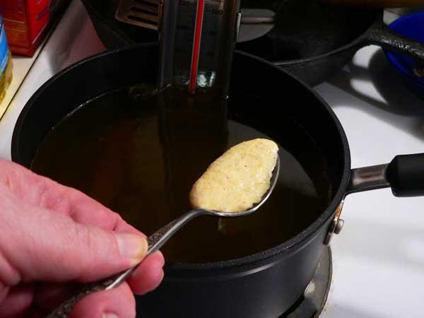 Hushpuppies, drop batter into hot oil.